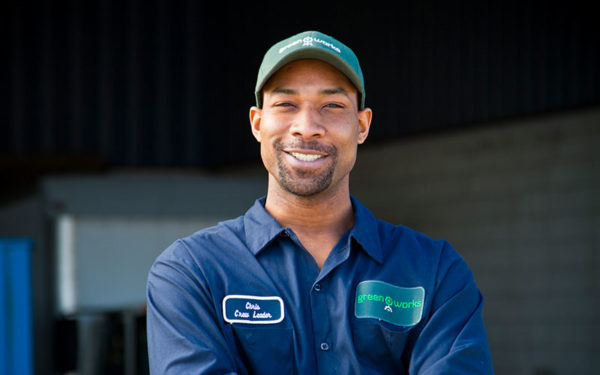 Image of smiling Goodwill Greenworks employee