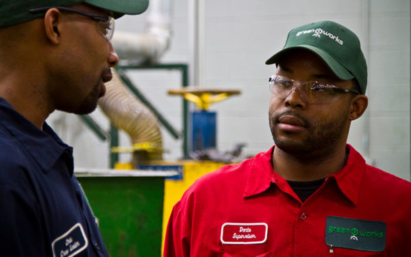 Image of two Goodwill Greenworks employees having a conversation