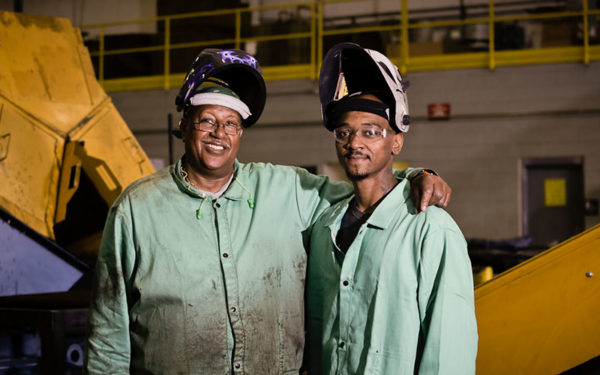 Image of two Goodwill Greenworks employees standing together