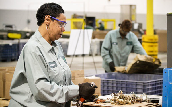 Image of woman working at Goodwill Greenworks